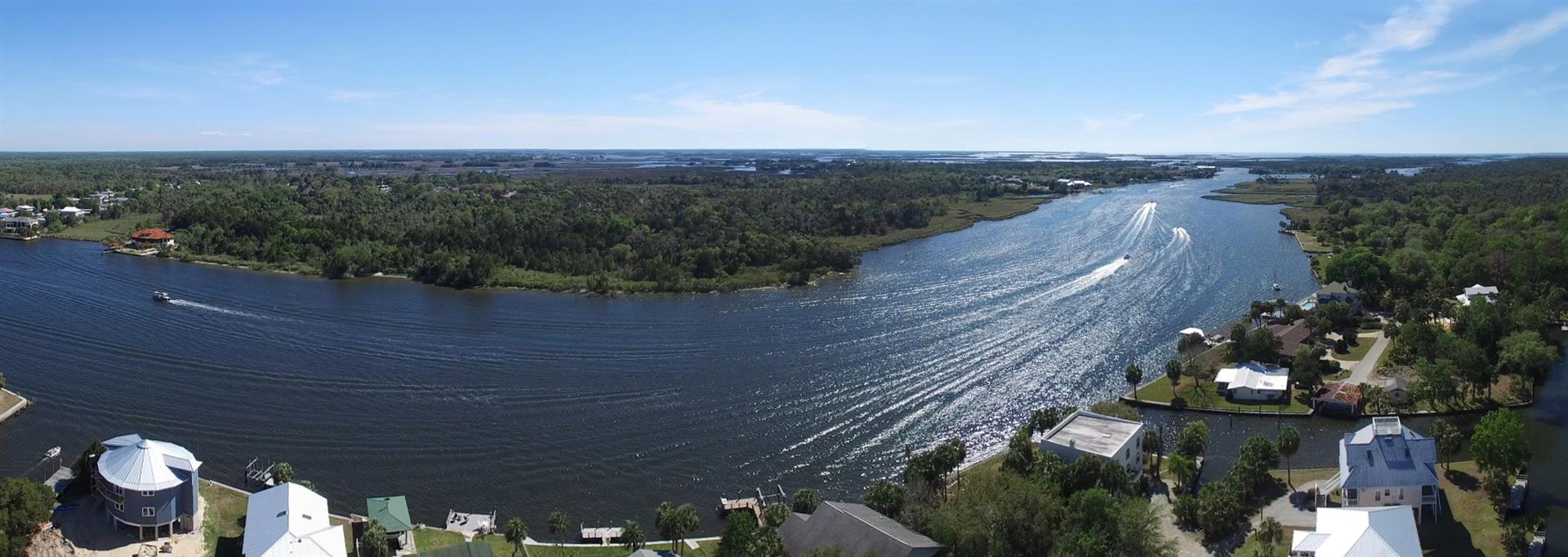 The Crystal River at Woodland Estates, aerial panorama shot with boats passing by